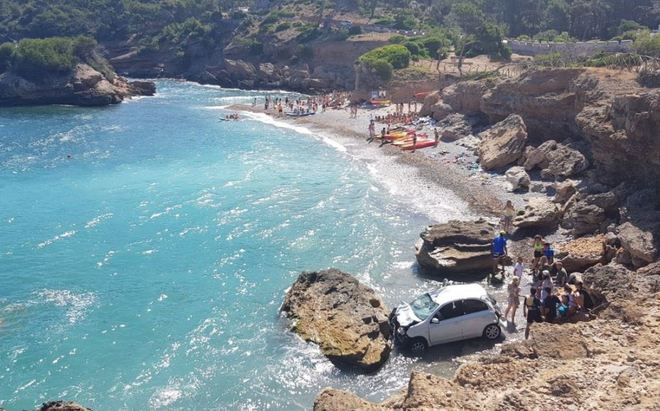 A couple of tourists make the wrong move and rush to the sea from a cliff in Mallorca