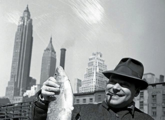 A fishmonger shows his genre at the Fulton Fish Market in New York, in 1943