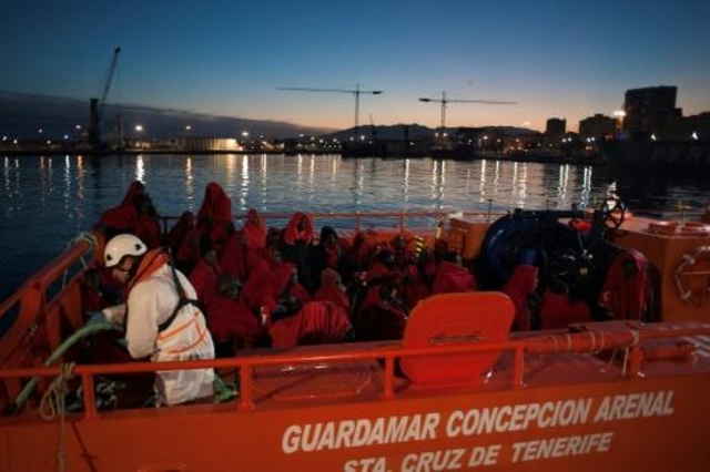 Immigrants arriving on a Spanish Coast Guard Vessel