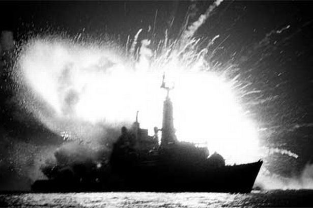 The heroic Argentine pilots and HMS Antelope at the time of the bomb explosion