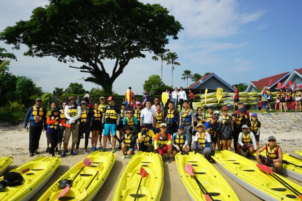 Volunteers collect trash in kayaks