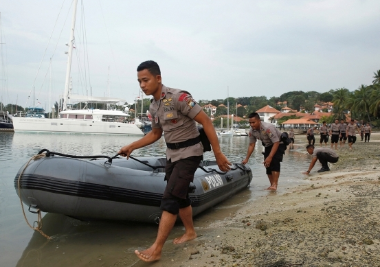 Indonesian police: At least 20 dead in boat capsizing
