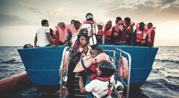 A Spanish aid worker, held in Italy for not returning refugees to Tripoli