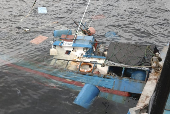 Fishermen were rescued minutes before their ship was sinking in the middle of the sea