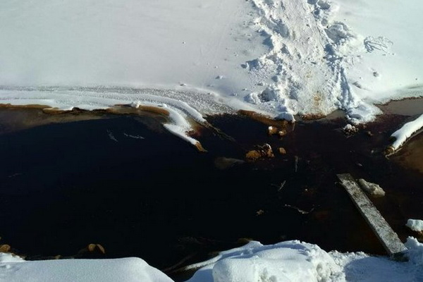 Oil Lake on the ice Angara created polluted groundwater