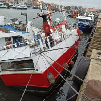 The Accumulation Of Sediments Causes A Fishing Vessel And A Civil Guard Boat To Run Aground